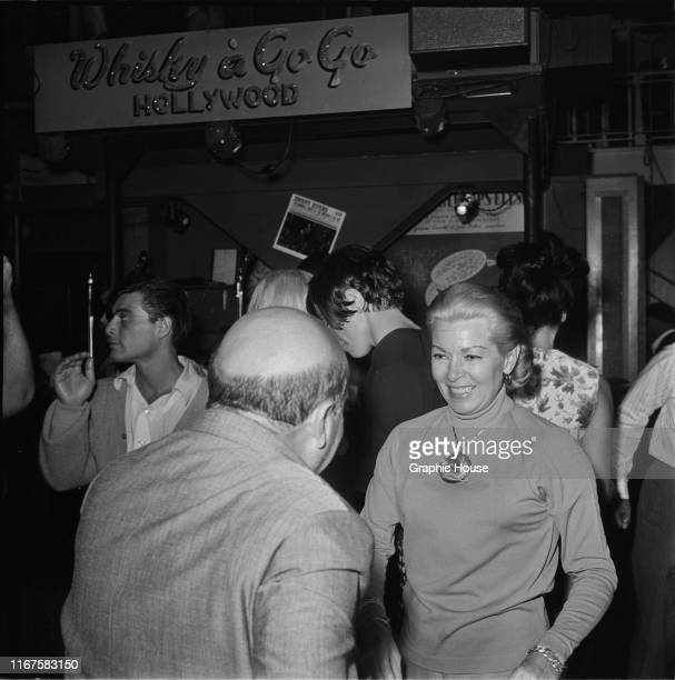 American actress Lana Turner dancing at Whisky A Go Go, a nightclub in West Hollywood, California, 1965.