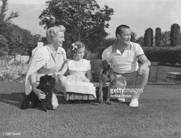 American actress Lana Turner with her third husband Bob Topping Cheryl Crane her daughter by second husband Steve Crane and two pet dogs at their...