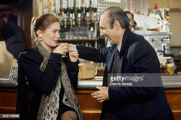 """American actress Lara Flynn Boyle with French actor Guy Marchand on the set of """"May Wine"""" , directed by Carol Wiseman."""