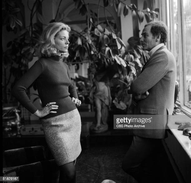 American actress Lauren Bacall and Italianborn fashion designer Pierre Cardin talk on the set of the CBS special 'The Paris Collections Fall Fashion...