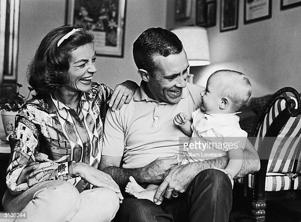 American actress Lauren Bacall with her second husband, Jason Robards and their baby son Sam, who grew up to follow his parents into show business.