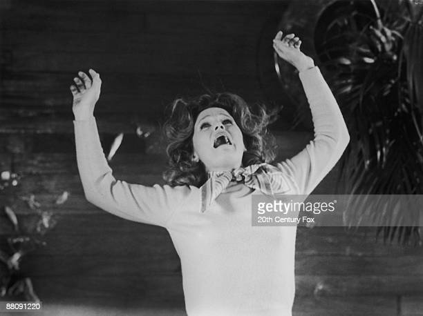 American actress Lee Remick as Katherine Thorn falls from a balcony after being hit by her son on his bicycle in a scene from 'The Omen' directed by...