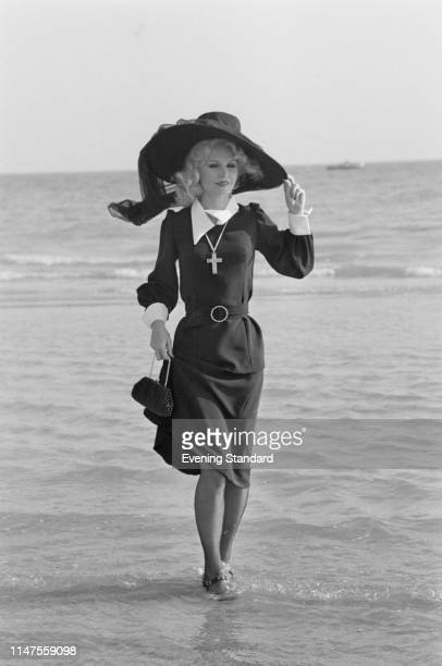 American actress Lee Remick as 'Nurse Fay McMahon' filming a scene of British comedy film 'Loot', UK, 23rd September 1969.