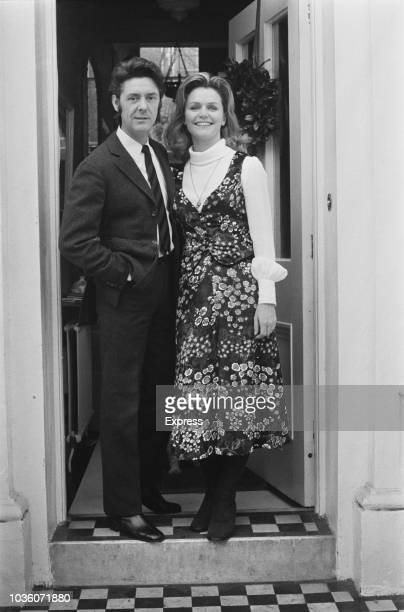 American actress Lee Remick pictured with her new husband British film producer and director William 'Kip' Gowans at the front door of a house in...