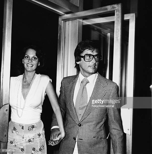 American actress Lesley Ann Warren and producer Robert Evans hold hands as they arrive at a screening of 'Parallax View' at the Screen Directors...