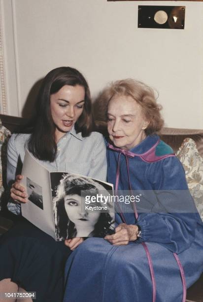 American actress Lillian Gish looks at old photographs of herself with Kate Revill who plays her in a new musical 'The Biograph Girl' at the Phoenix...