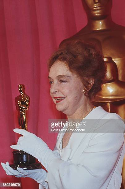 American actress Lillian Gish pictured holding her honorary Oscar statuette award as she attends the 43rd Academy Awards at the Dorothy Chandler...