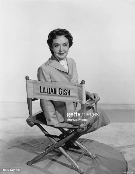 American actress Lillian Gish sitting in a director's chair with her name on it circa 1955