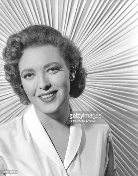 American actress Linda Darnell poses for a portrait in front of a backdrop of fabric arranged like a sunburst for the episode 'Terror in the Streets'...
