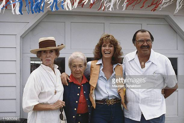 American actress Linda Gray on the set of the television soap opera 'Dallas' with her parents and an extra 18th July 1979