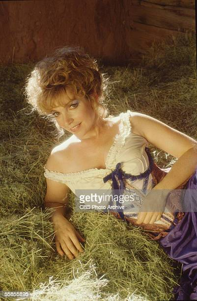 American actress Linda Gray reclines seductively in her undergarments on the hay in a publicity photo for the CBS television movie 'The Gambler Part...