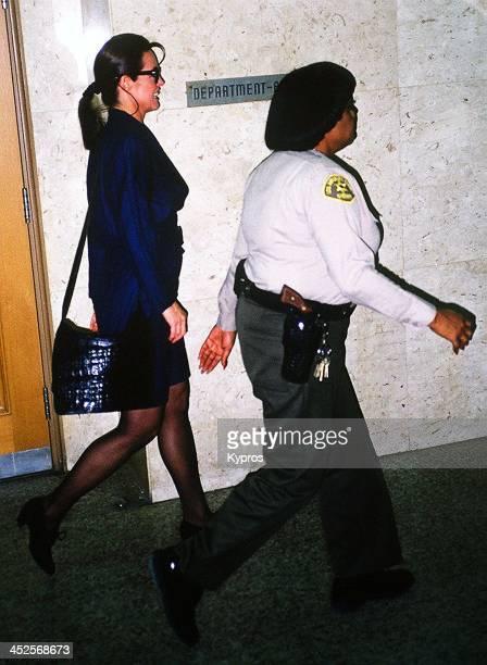 American actress Linda Gray with a police officer in Santa Monica California circa 1990