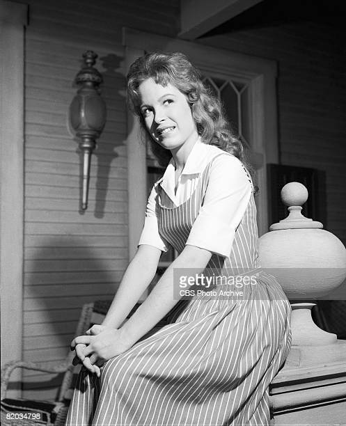 American actress Linda Henning sits on the porch of the Shady Rest Hotel on an episode of 'Petticoat Junction' entitled 'Kate's Recipe for Hot...