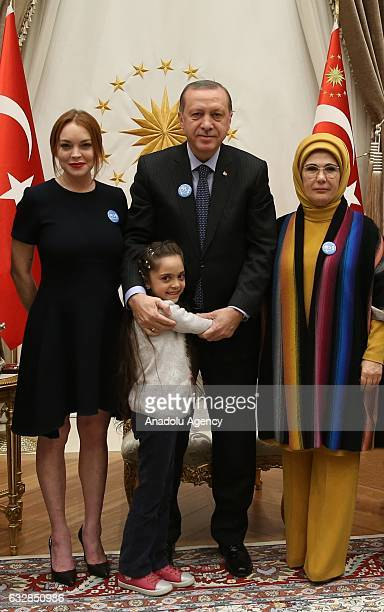 American actress Lindsay Lohan poses next to Turkish President Recep Tayyip Erdogan his wife Emine Erdogan and 7 years old Bana elAbed who sends...