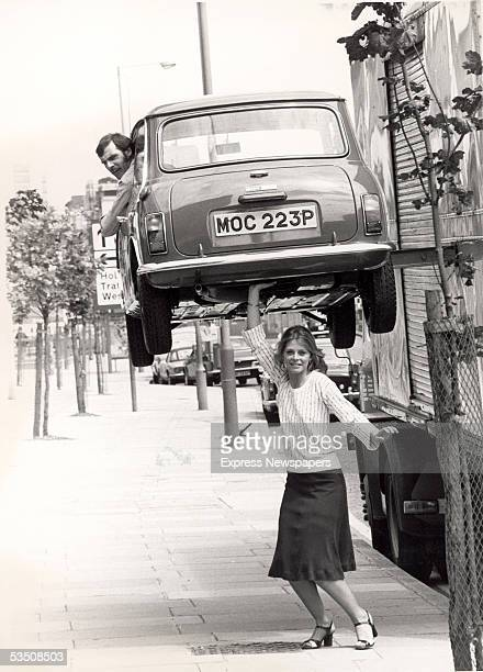 American actress Lindsay Wagner appears to hold a man in a Mini above her head during a visit to Britain to promote the television series 'The Bionic...