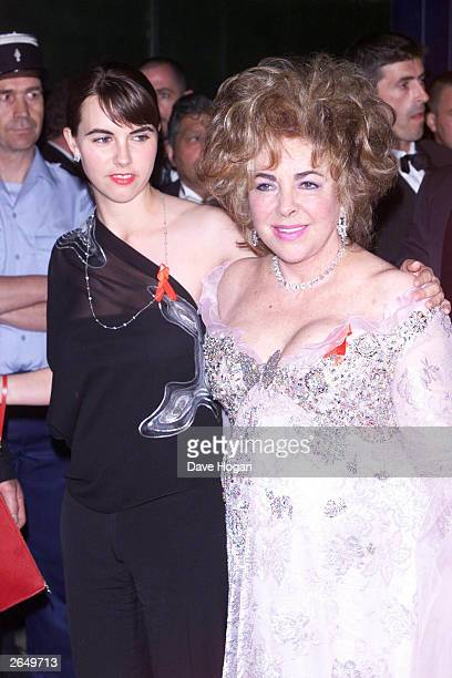 American actress Liz Taylor and her granddaughter attend the AMFAR dinner on May 10 2001 in Cannes