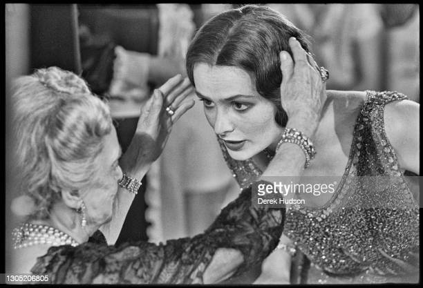 American actress Lois Chiles, a former fashion model, pictured on the film set of Death on the Nile having her hair adjusted by her co-star Bette...