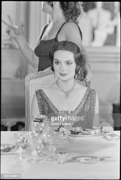 American actress Lois Chiles, a former fashion model, pictured on the film set of Death on the Nile wearing a diamond necklace choker, in which she...