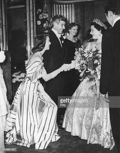 American actress Loretta Young curtsies to the Queen Mother at the Royal Command Film Performance at the Odeon Leicester Square London November 1947...
