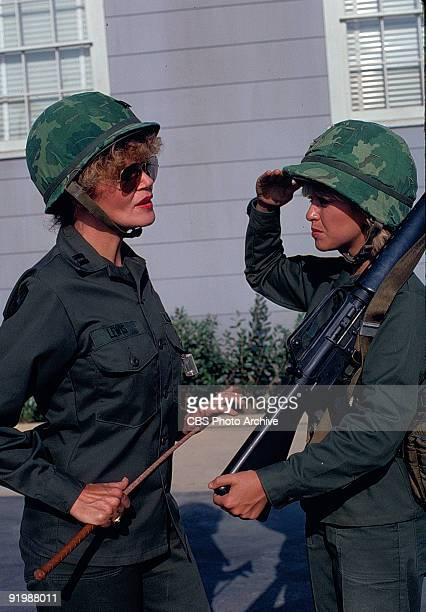 American actress Lorna Patterson salutes Eileen Brennan in a scene from an episode of the television show 'Private Benjamin' entitled 'Judy Got Her...
