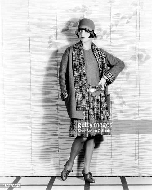 American actress Louise Brooks wearing a plaid coat skirt and cloche hat circa 1927