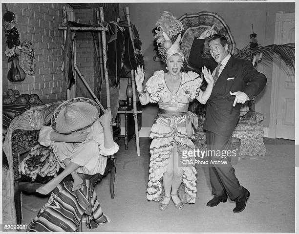 American actress Lucille Ball and her husband, Cuban actor Desi Arnaz dance backstage on the set of 'I Love Lucy,' Los Angeles, California, September...