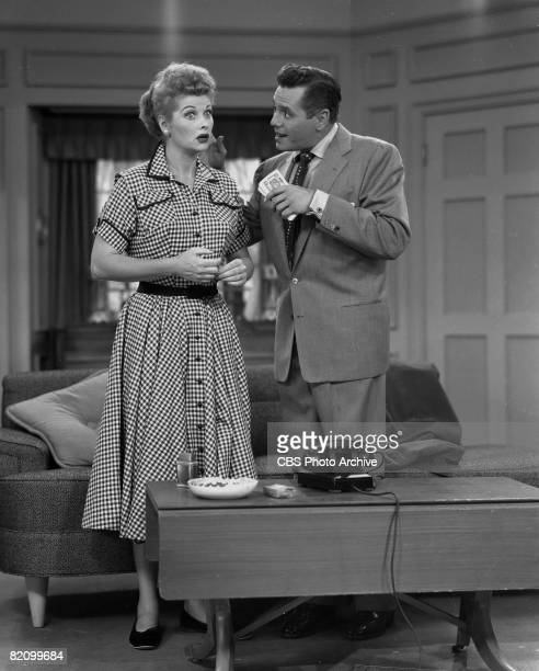 American actress Lucille Ball and her husband, Cuban actor Desi Arnaz talk in an episode of 'I Love Lucy,' Los Angeles, California, September 21,...