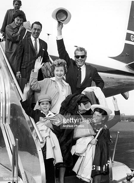 American actress Lucille Ball and her husband Desi Arnaz with their children Lucie and Desi Jr circa 1959 Behind them is actor William Holden