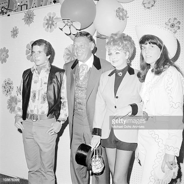 American actress Lucille Ball and her husband Gary Morton attend a charity fundraising event in westernstyle costumes circa 1965 With them are...