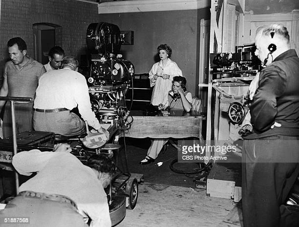 American actress Lucille Ball , her husband, Cuban-born American musician and actor Desi Arnaz , and the film crew on the set of the television...