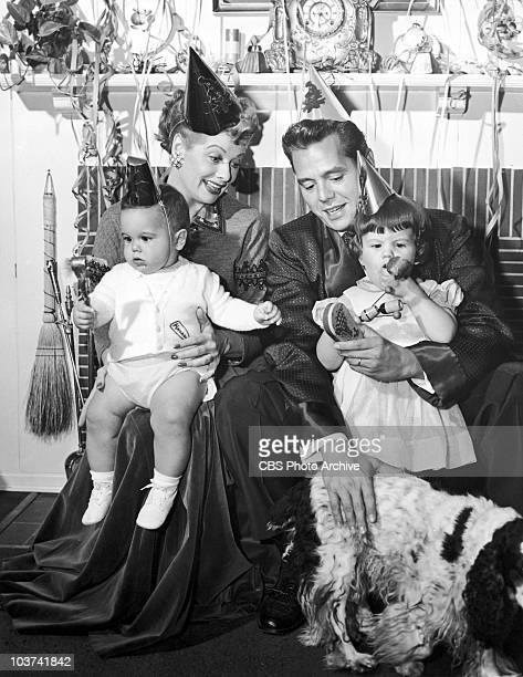 American actress Lucille Ball with her husband Desi Arnaz and their two children, Desi Jr. And Lucie Desiree, in a promotional shot for a New Year...