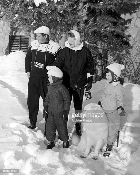 American actress Lucille Ball with her husband Desi Arnaz and their children Lucie and Desi Jr during a holiday in the snow circa 1957