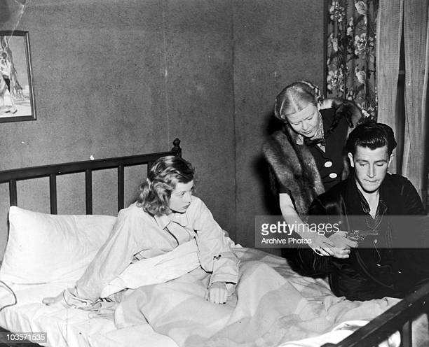American actress Lucille Ball with Lela Rogers and John Shelton on the set of the film 'Breakfast with Lenora' circa 1936