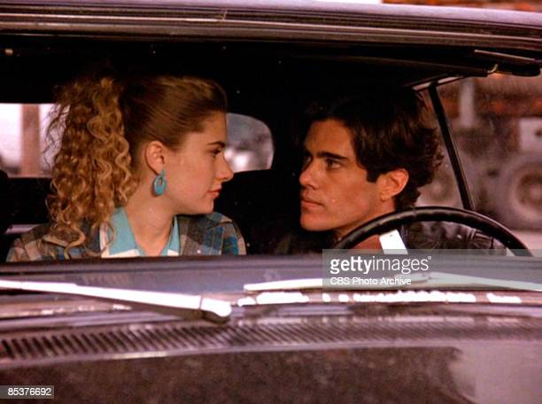 American actress Madchen Amick talks with actor Dana Ashbrook in the front seat of a car with in a scene from the pilot episode of the television...