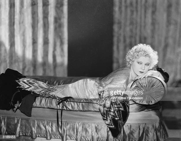 American actress Mae West, born Mary Jane West , in a relaxing pose.