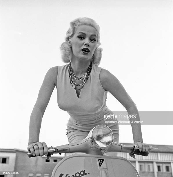 American actress Mamie Van Doren posing on a Vespa in a provocative way Rome