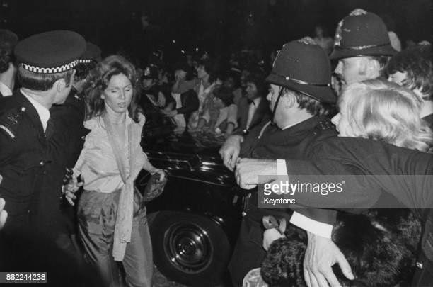 American actress Marilu Henner the girlfriend of actor John Travolta makes her way through fans outside the Empire Leicester Square at the UK...