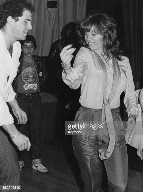 American actress Marilu Henner the girlfriend of actor John Travolta dancing at the Lyceum during an afterparty for the UK premiere of 'Grease' 13th...