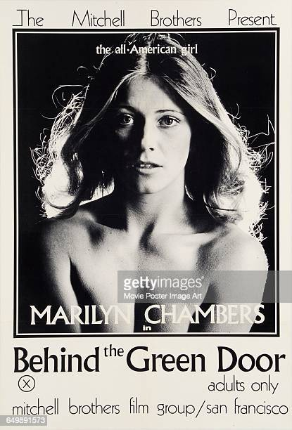 Image contains suggestive contentAmerican actress Marilyn Chambers appears on the poster for the pornographic film 'Behind the Green Door' directed...