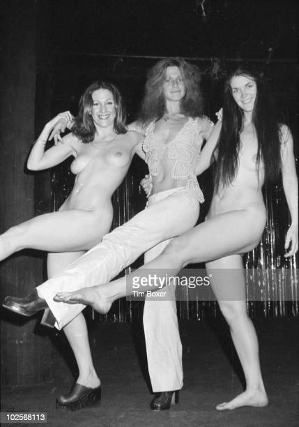 American actress Marilyn Chambers performs leg kicks with actresses Tobie Columbus and Lorraine Davidson from the cast of 'Let My People Come A...