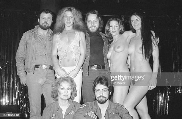 American actress Marilyn Chambers poses with cast and crew members from 'Let My People Come A Sexual Musical' at the Village Gate New York New York...