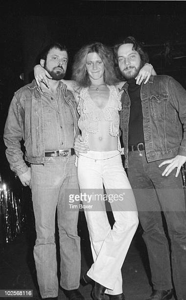 American actress Marilyn Chambers poses with producer/director Phil Oesterman and writer/lyricist Earl Wilson Jr from 'Let My People Come A Sexual...