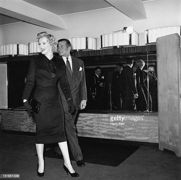 American actress Marilyn Monroe and English actor and director Laurence Olivier during a press conference at the Savoy Hotel, London, July 1956....