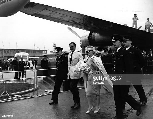 American actress Marilyn Monroe arrives at London airport with her husband playwright Arthur Miller Original Publication People Disc HW0690