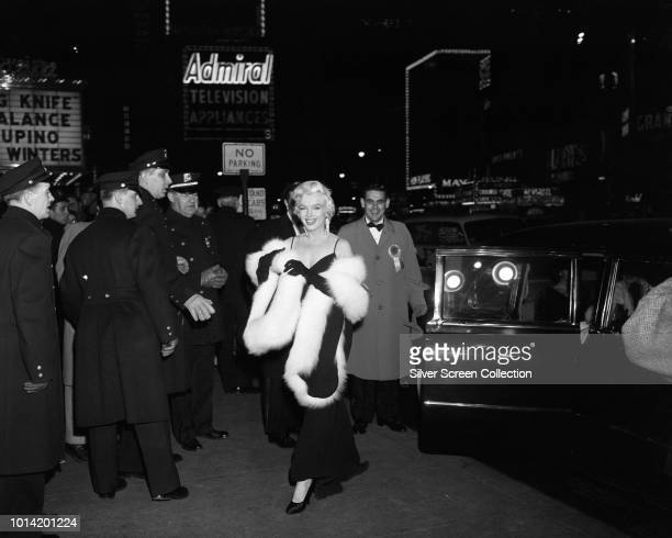 American actress Marilyn Monroe arrives at the premiere of 'The Rose Tattoo' at the Astor Theatre in Times Square New York City 12th December 1955