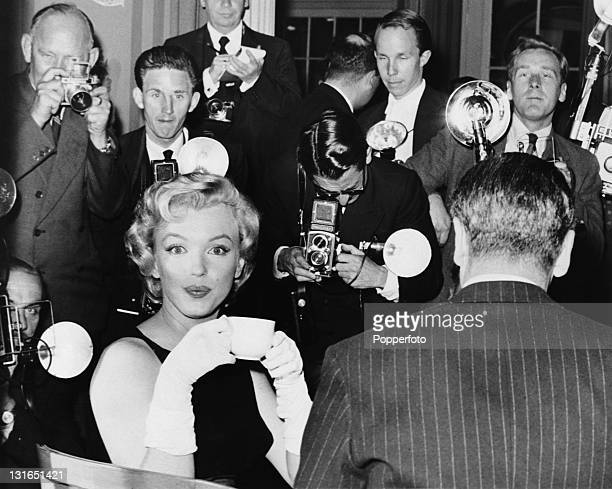 American actress Marilyn Monroe at a press conference at the Savoy Hotel, London, July 1956. Monroe is in England to film 'The Prince and the...