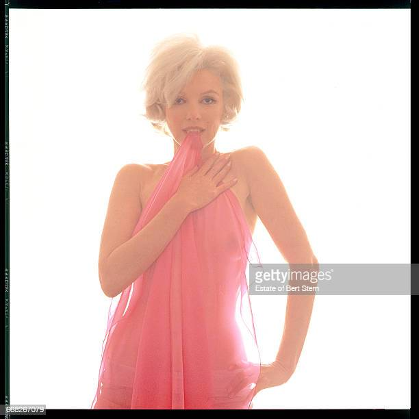 American actress Marilyn Monroe biting a pink scarf Beverly Hills California June 1962 The two sessions for the photoshoot took place in late June...
