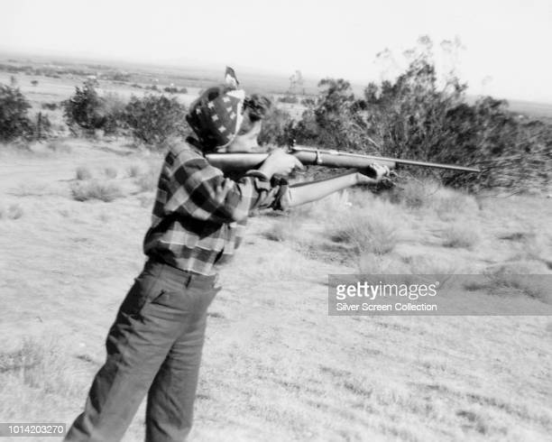 American actress Marilyn Monroe born Norma Jean Mortenson shooting a rifle circa 1945