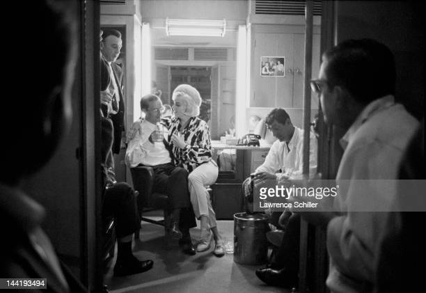 American actress Marilyn Monroe celebrates her birthday with among others her costars actors Wally Cox and Dean Martin in Martin's dressing room...