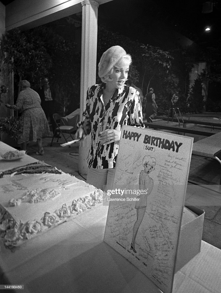 American Actress Marilyn Monroe Cuts Her Birthday Cake During The